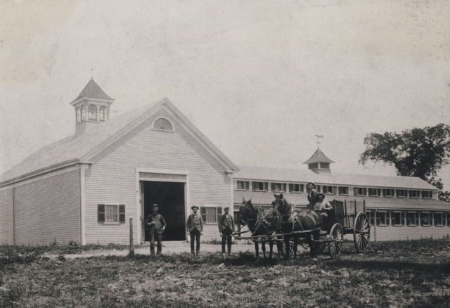 Milk delivery truck in front of the Edward Jennings Barn, early 20th c.