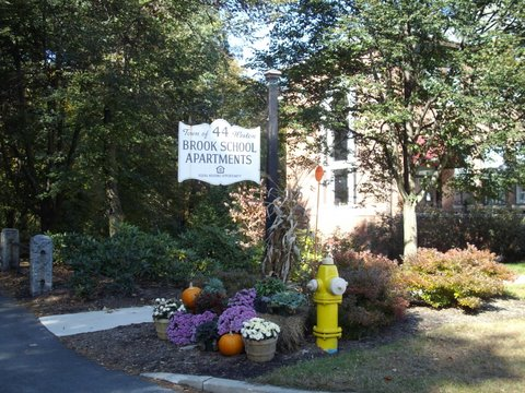 The entrance sign for the Brook School Apartments