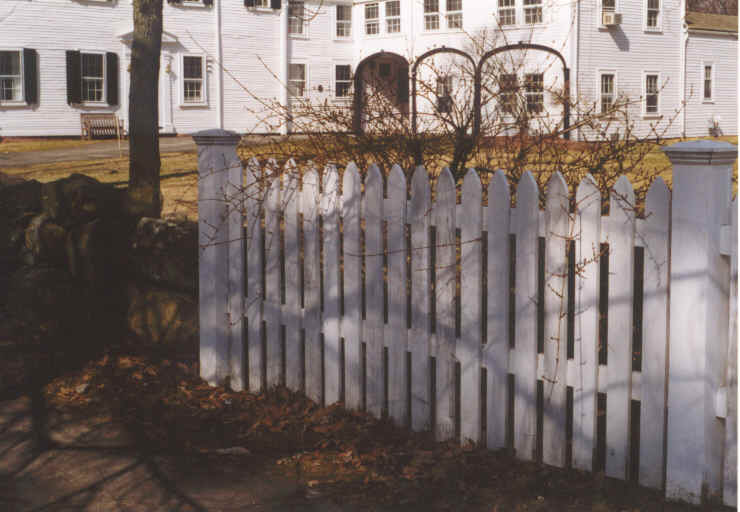 White Picket Fence with House in Background