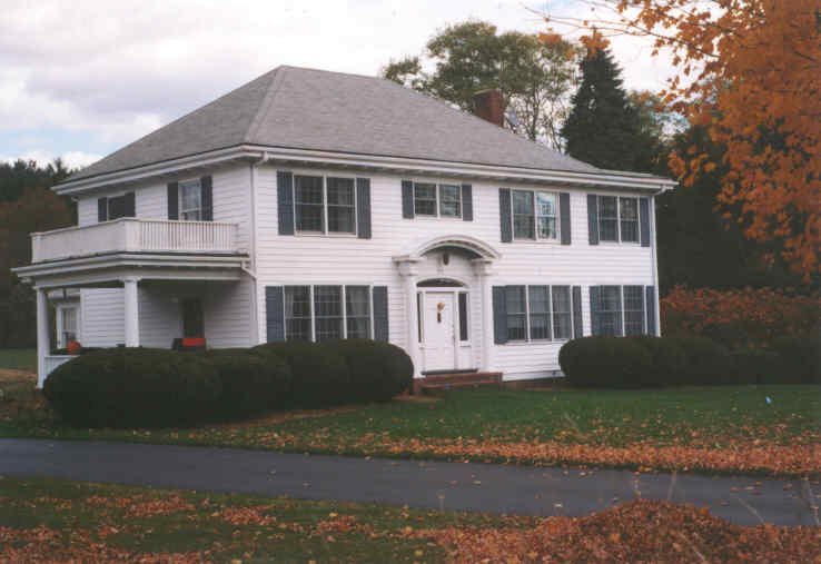A large Colonial style house with a porch