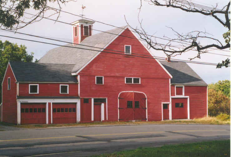 an old red barn known as the coburn barn on church street