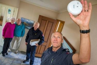 two firefighters checking home safety