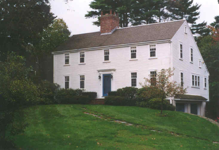 A colonial style house with a blue door