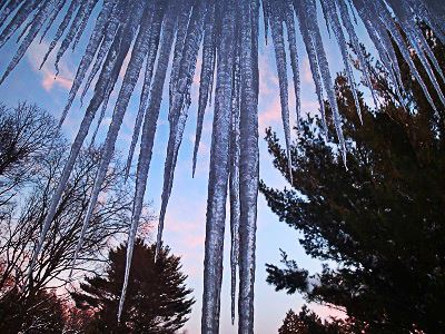 icicles with sunset in background